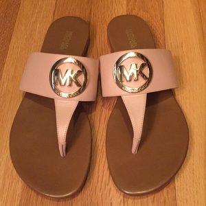Michael Kors slippers.